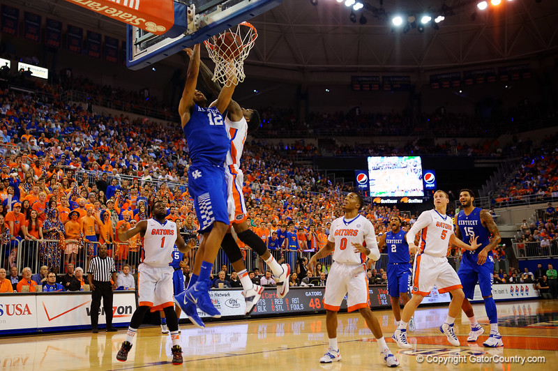 Kentucky Wildcats forward Karl-Anthony Towns slams the ball in over Florida Gators forward Chris Walker during the second half.  Florida Gators vs Kentucky Wildcats.  February 7th, 2015. Gator Country photo by David Bowie.