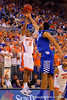 Florida Gators guard Kasey Hill takes a shot but has it blocked by Kentucky Wildcats forward Karl-Anthony Towns during the first half.  Florida Gators vs Kentucky Wildcats.  February 7th, 2015. Gator Country photo by David Bowie.