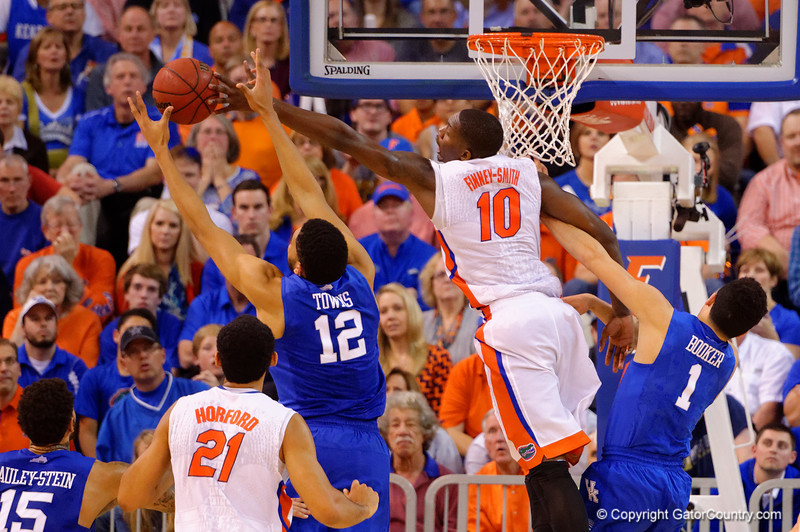 Florida Gators forward Dorian Finney-Smith fights for a rebound against Kentucky Wildcats forward Karl-Anthony Towns during the second half.  Florida Gators vs Kentucky Wildcats.  February 7th, 2015. Gator Country photo by David Bowie.