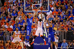 Kentucky Wildcats forward Marcus Lee tries to block the shot by Florida Gators guard Eli Carter during the second half.  Florida Gators vs Kentucky Wildcats.  February 7th, 2015. Gator Country photo by David Bowie.