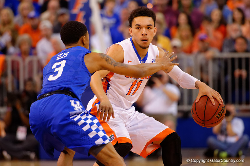 Florida Gators guard Chris Chiozza dribbles up court being guarded by Kentucky Wildcats guard Tyler Ulis.  Florida Gators vs Kentucky Wildcats.  February 7th, 2015. Gator Country photo by David Bowie.