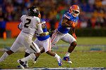 Florida Gators running back Kelvin Taylor rushes to get to the outside during the third quarter.  Florida Gators vs Missouri Tigers.  October 18th, 2014. Gator Country photo by David Bowie.