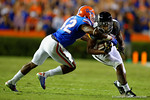 Missouri Tigers wide receiver Bud Sasser is tackled by Florida Gators defensive back Keanu Neal during the second quarter.  Florida Gators vs Missouri Tigers.  October 18th, 2014. Gator Country photo by David Bowie.