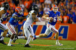 Florida Gators quarterback Jeff Driskel scrambles to his left looking downfield for an open receiver during the first quarter.  Florida Gators vs Missouri Tigers.  October 18th, 2014. Gator Country photo by David Bowie.