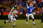 Florida Gators quarterback Treon Harris throws on the run during the third quarter.  Florida Gators vs Missouri Tigers.  October 18th, 2014. Gator Country photo by David Bowie.