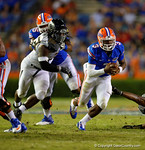 Florida Gators quarterback Treon Harris rushes upfield late in the fourth quarter.  Florida Gators vs Missouri Tigers.  October 18th, 2014. Gator Country photo by David Bowie.