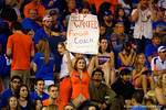 A Florida Gators fan holds up a sign asking for a change at the coaching position.  Florida Gators vs Missouri Tigers.  October 18th, 2014. Gator Country photo by David Bowie.