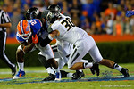 Florida Gators running back Kelvin Taylor is brought down by Missouri Tigers linebacker Michael Scherer during the first quarter.  Florida Gators vs Missouri Tigers.  October 18th, 2014. Gator Country photo by David Bowie.