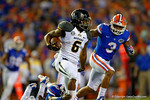 Missouri Tigers tailback Marcus Murphy cuts up field and rushes for a first down as Florida Gators linebacker Antonio Morrison races to catch him during the first quarter.  Florida Gators vs Missouri Tigers.  October 18th, 2014. Gator Country photo by David Bowie.