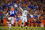 Missouri Tigers quarterback Maty Mauk throws downfield before Florida Gators defensive lineman Bryan Cox, Jr. can make the tackle late in the second quarter.  Florida Gators vs Missouri Tigers.  October 18th, 2014. Gator Country photo by David Bowie.