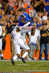 Florida Gators wide receiver Ahmad Fulwood leaps into the air while being covered by Missouri Tigers cornerback John Gibson for a reception during the third quarter.  Florida Gators vs Missouri Tigers.  October 18th, 2014. Gator Country photo by David Bowie.