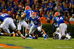 Florida Gators offensive lineman Roderick Johnson looks down at the loose ball after the ball was knocked loose from Florida Gators quarterback Treon Harris.  Florida Gators vs Missouri Tigers.  October 18th, 2014. Gator Country photo by David Bowie.