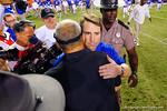 Florida Gators Head Coach Will Muschamp greets Missouri Tigers head coach Gary Pinkel at midfield following the Gators loss.  Florida Gators vs Missouri Tigers.  October 18th, 2014. Gator Country photo by David Bowie.