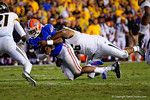 Florida Gators quarterback Treon Harris is tackled by a Missouri defender during the fourth quarter.  Florida Gators vs Missouri Tigers.  October 18th, 2014. Gator Country photo by David Bowie.
