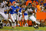 Missouri Tigers tailback Russell Hansbrough rushes upfield while being chased by Florida Gators safety Duke Dawson.  Florida Gators vs Missouri Tigers.  October 18th, 2014. Gator Country photo by David Bowie.