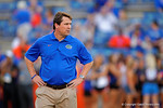 Florida Gators Head Coach Will Muschamp walks the field watching his team warm up prior to the start of the game against Missouri.  Florida Gators vs Missouri Tigers.  October 18th, 2014. Gator Country photo by David Bowie.
