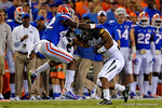 Florida Gators defensive back Keanu Neal tackles the Missouri player before reaching the first down marker during the first quarter.  Florida Gators vs Missouri Tigers.  October 18th, 2014. Gator Country photo by David Bowie.