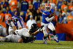 Florida Gators quarterback Treon Harris avoids the diving tackle by the Missouri defender and rushes upfield during the fourth quarter.  Florida Gators vs Missouri Tigers.  October 18th, 2014. Gator Country photo by David Bowie.