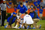 Florida Gators Head Coach Will Muschamp comes out to check on Florida Gators quarterback Jeff Driskel during the second quarter.  Florida Gators vs Missouri Tigers.  October 18th, 2014. Gator Country photo by David Bowie.