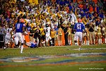 Missouri Tigers tailback Marcus Murphy takes a kickoff for a touchdown as the Missouri fans cheer on during the third quarter.  Florida Gators vs Missouri Tigers.  October 18th, 2014. Gator Country photo by David Bowie.
