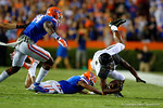 Missouri Tigers wide receiver Bud Sasser is upended by the tackle of Florida Gators defensive back Vernon Hargreaves, III during the second quarter.  Florida Gators vs Missouri Tigers.  October 18th, 2014. Gator Country photo by David Bowie.