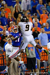 Missouri Tigers safety Braylon Webb leaps over Florida Gators wide receiver Demarcus Robinson to make the catch for the third interception by Missouri of the evening.  Florida Gators vs Missouri Tigers.  October 18th, 2014. Gator Country photo by David Bowie.