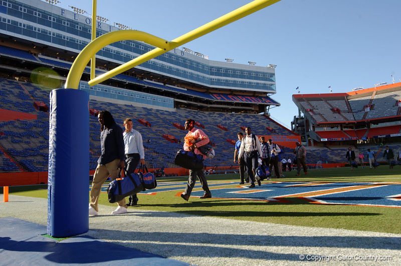 The Florida Gators march across the field and into the locker room during Gator Walk.