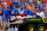 Florida Gators tight end Jake McGee is carted off the field following his tibia and fibula being broken.  Florida Gators vs Eastern Michigan Eagles.  September 6th, 2014. Gator Country photo by David Bowie.