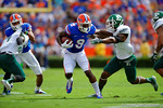 Florida Gators wide receiver Latroy Pittman attempts a stiff arm trying to break break of the tackle by an Eastern Michigan defender.  Florida Gators vs Eastern Michigan Eagles.  September 6th, 2014. Gator Country photo by David Bowie.