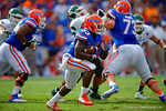 Florida Gators running back Mack Brown rushes around the outside tring to pick up the first down.  Florida Gators vs Eastern Michigan Eagles.  September 6th, 2014. Gator Country photo by David Bowie.