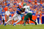 Florida Gators linebacker Neiron Ball makes the hit on third and two to stop Eastern Michigan running back Bronson Hill from picking up the first down.  Florida Gators vs Eastern Michigan Eagles.  September 6th, 2014. Gator Country photo by David Bowie.