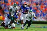 Florida Gators running back Matt Jones avoids the Eastern Michigan defense and rushes into the endzone for a 40 yard touchdown.  Florida Gators vs Eastern Michigan Eagles.  September 6th, 2014. Gator Country photo by David Bowie.