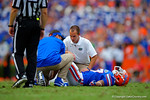 Florida Gators defensive lineman Jordan Sherit is tended to by the Florida Gators training staff.  Florida Gators vs Eastern Michigan Eagles.  September 6th, 2014. Gator Country photo by David Bowie.