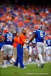 Florida Gators defensive coordinator D.J. Durkin congratulates Florida Gators defensive lineman Dante Fowler, Jr. after the defense stopped the Eastern Michigan offense once again.  Florida Gators vs Eastern Michigan Eagles.  September 6th, 2014. Gator Country photo by David Bowie.