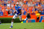 Florida Gators wide receiver Andre Debose returns the punt return for 65 yards.  Florida Gators vs Eastern Michigan Eagles.  September 6th, 2014. Gator Country photo by David Bowie.
