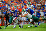 Florida Gators running back Brandon Powell avoids the diving Eastern Michigan defender on his way to his first touchdown as a Florida Gator.  Florida Gators vs Eastern Michigan Eagles.  September 6th, 2014. Gator Country photo by David Bowie.