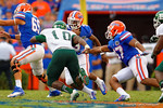 Florida Gators quarterback Treon Harris scrambles upfield.  Florida Gators vs Eastern Michigan Eagles.  September 6th, 2014. Gator Country photo by David Bowie.