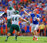 Florida Gators quarterback Jeff Driskel throws over the outstretched arm of Eastern Michigan defensive back Darius Scott.  Florida Gators vs Eastern Michigan Eagles.  September 6th, 2014. Gator Country photo by David Bowie.