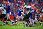 Florida Gators quarterback Treon Harris takes the snap and scrambles out of the pocket.  Florida Gators vs Eastern Michigan Eagles.  September 6th, 2014. Gator Country photo by David Bowie.
