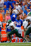 Florida Gators wide receiver Andre Debose leaps into the air over the Eastern Michigan defender to try to make the catch.  Florida Gators vs Eastern Michigan Eagles.  September 6th, 2014. Gator Country photo by David Bowie.