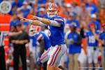 Florida Gators quarterback Jeff Driskel signals to his offense and makes an anjustment.  Florida Gators vs Eastern Michigan Eagles.  September 6th, 2014. Gator Country photo by David Bowie.