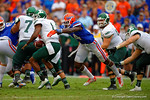 Florida Gators defensive lineman Alex McCalister sacks Eastern Michigan quarterback Rob Bolden .  Florida Gators vs Eastern Michigan Eagles.  September 6th, 2014. Gator Country photo by David Bowie.