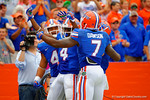 Florida Gators Duke Dawson, Hunter Joyer and Andre Debose celebrate following Debose' long punt return.  Florida Gators vs Eastern Michigan Eagles.  September 6th, 2014. Gator Country photo by David Bowie.