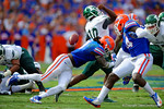Florida Gators linebacker Neiron Ball hits Eastern Michigan quarterback Reginald Bell in the back causing a fumble.  Florida Gators vs Eastern Michigan Eagles.  September 6th, 2014. Gator Country photo by David Bowie.
