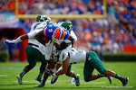 Florida Gators wide receiver Latroy Pittman is upended on the tackle.  Florida Gators vs Eastern Michigan Eagles.  September 6th, 2014. Gator Country photo by David Bowie.