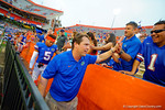 Florida Gators Head Coach Will Muschamp shakes hands with the fans following the win over Eastern Michigan.  Florida Gators vs Eastern Michigan Eagles.  September 6th, 2014. Gator Country photo by David Bowie.