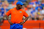 Florida Gators defensive backs coach Travaris Robinson watches on as his defensive backs warm up prior to the start of the game.  Florida Gators vs Eastern Michigan Eagles.  September 6th, 2014. Gator Country photo by David Bowie.
