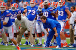 Florida Gators Head Coach Will Muschamp and Florida Gators tight ends coach Derek Lewis watch on as the Gator offense runs pre-game drills.  Florida Gators vs Eastern Michigan Eagles.  September 6th, 2014. Gator Country photo by David Bowie.
