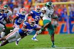 Florida Gators defensive back Keanu Neal dives to make the tackle on Eastern Michigan running back Ian Eriksen.  Florida Gators vs Eastern Michigan Eagles.  September 6th, 2014. Gator Country photo by David Bowie.