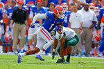Florida Gators wide receiver Quintan Dunbar makes the catch and sprints downfield.  Florida Gators vs Eastern Michigan Eagles.  September 6th, 2014. Gator Country photo by David Bowie.